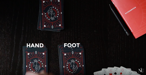 (The set up of a traditional Hand and Foot game)