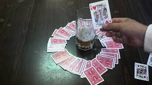 (In Kings, players draw random cards from a ring shaped pile.)
