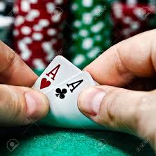 (In Guts, the pair of Aces is the highest hand a player can receive.)