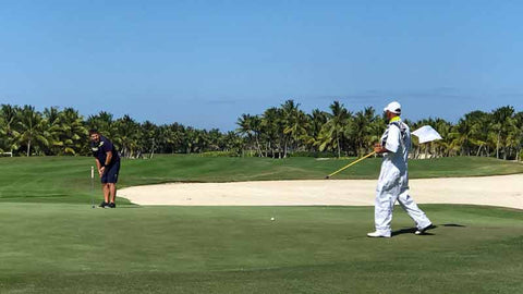 Golfer and Caddie at La Cana Punta Cana