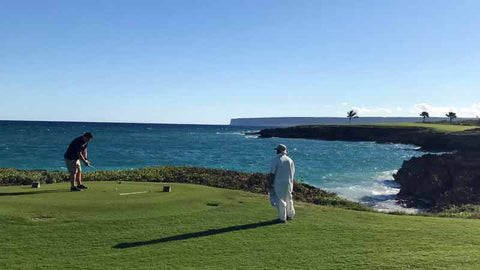 Golfer and Caddie at 12th teebox Punta Espada