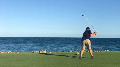 golfer teeeing off on 18 at Punta Espada Golf Course