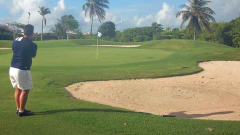Chipping to green at Iberostar Cancun