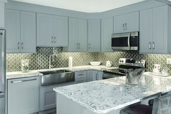 GRAY  When it comes to kitchen cabinets today, gray is the trending color. Due to its neutral appearance, it is becoming popular in many tones. Darker shades impact in a dramatic way, while lighter tints are more luminous.