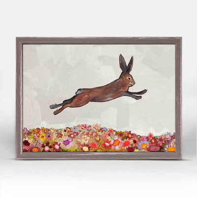 Brown Bunny Jumping Over Flowers Framed Canvas