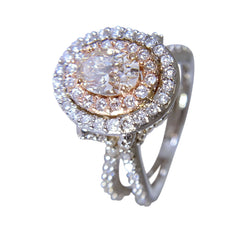 14 WHITE AND ROSE GOLD OVAL DIAMOND RING - 2.48 CT