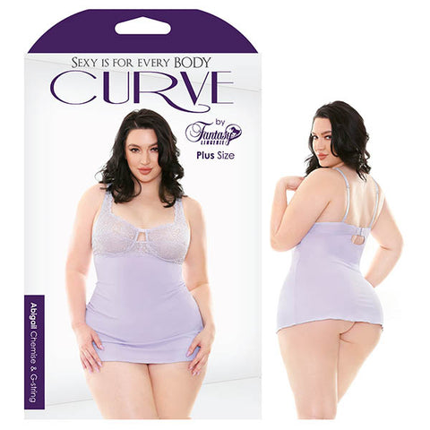 Curve Abigail Chemise & G-String Fantasy Lingerie The showstopping Abigail lace chemise and G-string is set in a tranquil lilac hue. Underwire support, hook & eye closure and adjustable straps for just the right fit. Soft microfibre fabric makes this style a necessity to any lingerie collection. Features: - Underwire Cups - Soft Microfibre Fabric - Intricate Floral Lace - Hook & Eye Closure - Adjustable Straps Colour: Lilac Purple Fabric Content: 90% Polyamide, 10% Spandex Washing Instructions: Hand