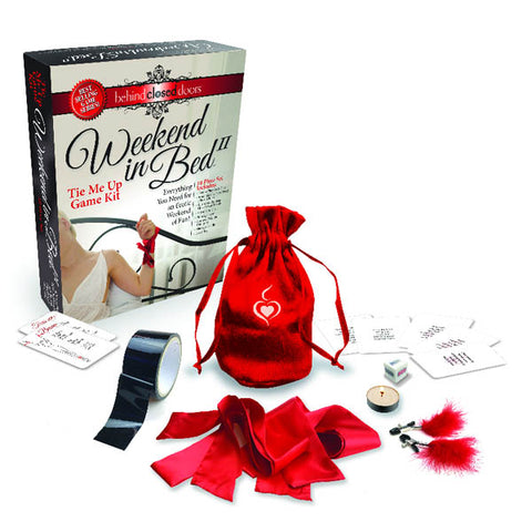Behind Closed Doors - Weekend In Bed II Little Genie This Game/Kit offers sexy adventures that explore light, playful bondage. Weekend in Bed II, Tie Me Up Edition includes 3 high-quality satin ties, stick-to-itself vinyl bondage tape, feathered nipple clamps, tea candle, illustrated position suggestion cards, playful scenario cards, his/her die, and a convenient red satin travel bag. This new edition encourages seductive experimentation and complements our original Weekend in Bed Game Kit.