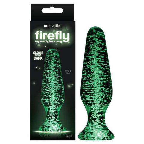 Firefly Glass Tapered Glass Plug NS Novelties Firefly Glass - dreamy, playful and functional. Seductive and enticing, these glow in the dark little wonders are your ticket for endless fun when the sun goes down. Made of superior quality borosilicate glass with proven shapes designed to perform. Available in assorted sizes and suitable for all lubricants. Turn off the lights and turn on the fun. Product Dimensions: 8.4 cm x 4 cm x 2.5 cm Product Material: Glass