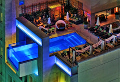 joule hotel dallas roof top pool night city lights