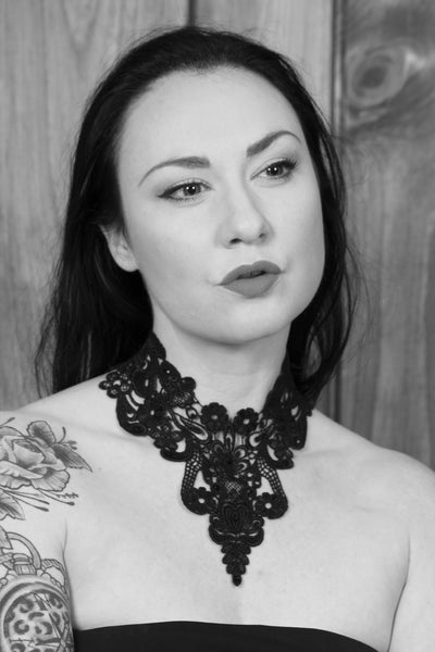 girl model wearing a black lace choker by arthlin jewelry llc black and white