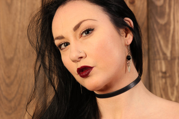 Model wearing trendy 10mm black leather choker made in USA by Arthlin jewelry