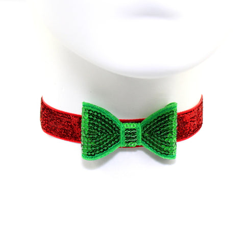 green sequin bow set on sparkly red choker on manaquin, handmade by arthlin jewelry