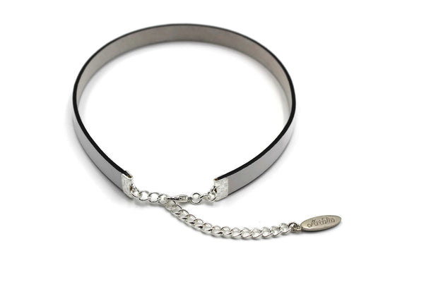 Top view of narrow white leather choker with black edging arthlin jewlery