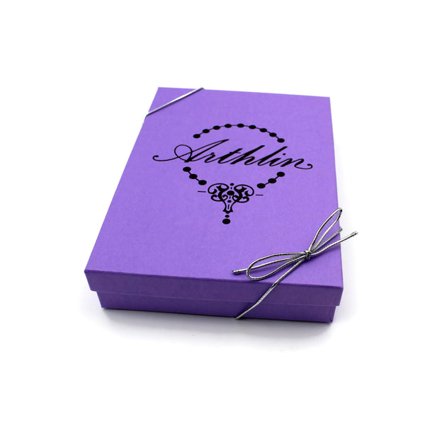 purple gift box with silver ribbon stamped with arthlin jewelry handmade in maine