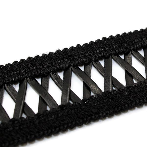 close up of criss-cross pattern on black choker from arthlin jewelry