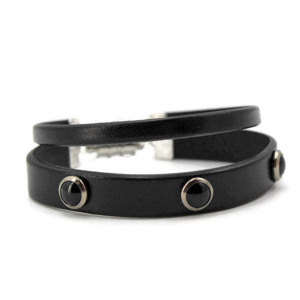 pair of 10mm and 5mm black leather bracelets, stacked, 10 mm adorned with jet cabochon studs, magnetic clasp, arthlin jewelry