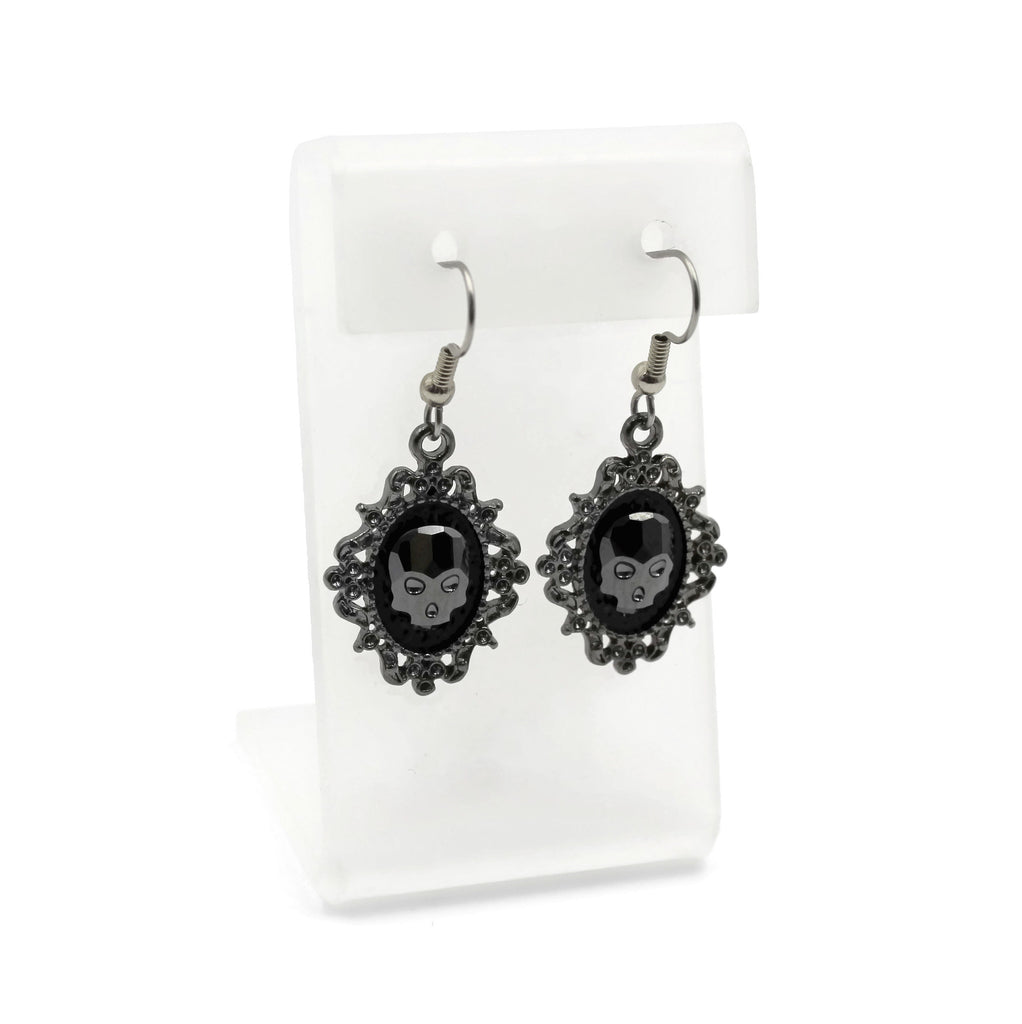 black glass skull design set in ornate gun metal frame, arthlin jewelry, handmade in maine