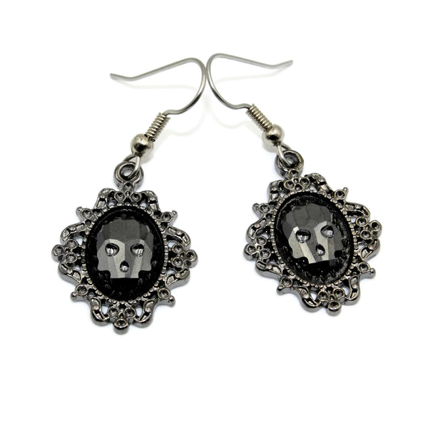 crystal skull earrings in ornate gunmetal frame, arthlin jewelry, handmade in maine