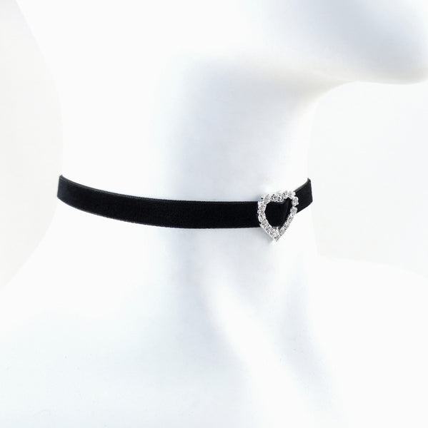 side view of mannequin wearing black velvet choker with rhinestone heart slide pendant centered on necklace, arthlin jewelry