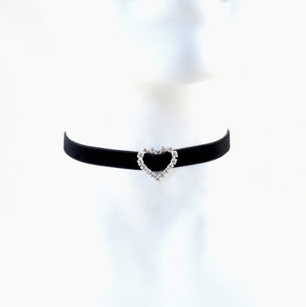 close up of mannequin wearing black velvet choker with rhinestone heart slide, handmade in maine by arthlin jewelry