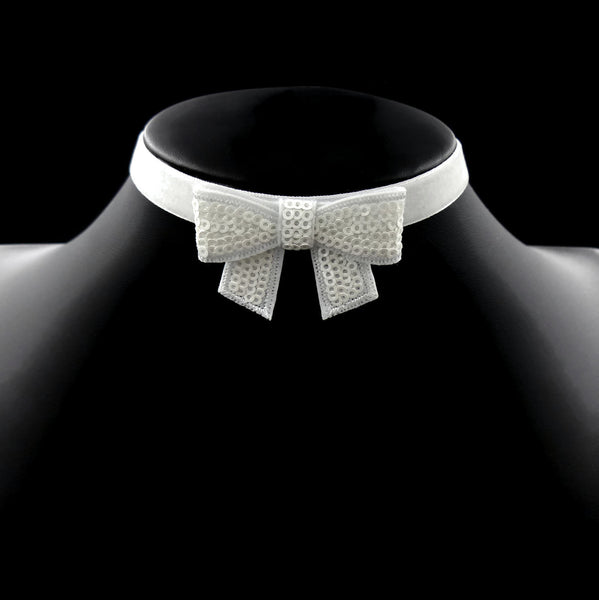 white velvet choker with white sparkly bow made by arthlin jewlery llc handmade in maine