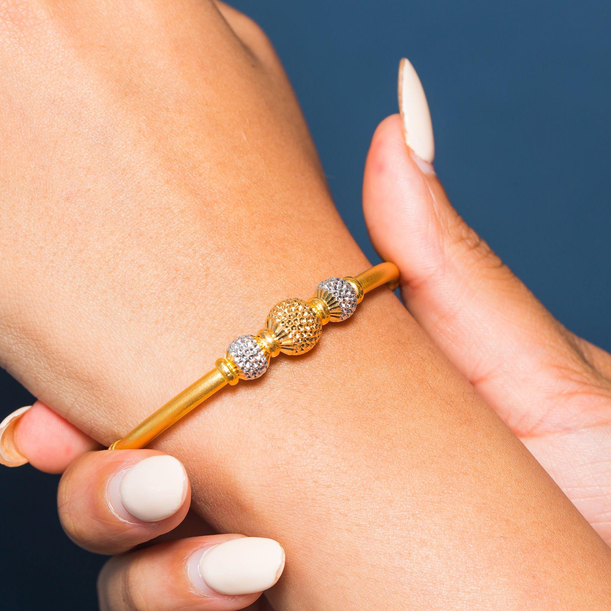 22K Multi Tone Gold Bangle W/ 3 Accent Dimpled Balls