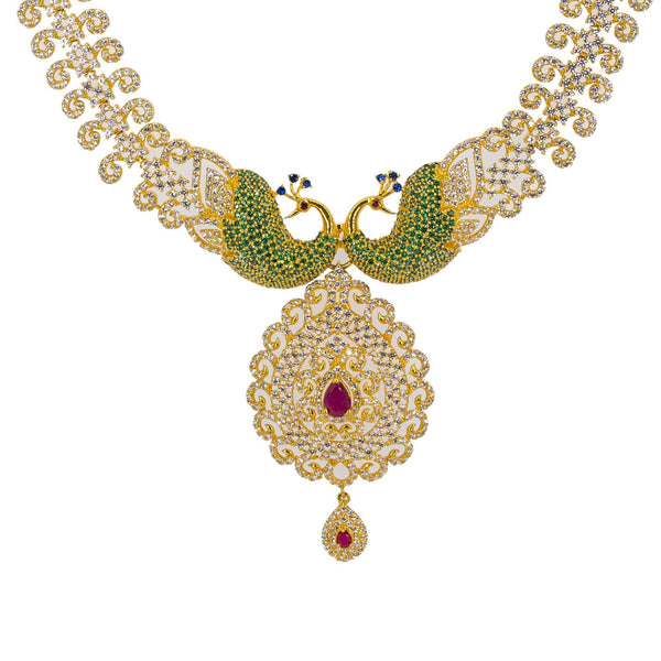 A close-up image of the 22K gold pendant and peacock accents on the necklace from Virani Jewelers. | Make your evening one to remember with this gorgeous 22K gold necklace from Virani Jewelers!  Fea...