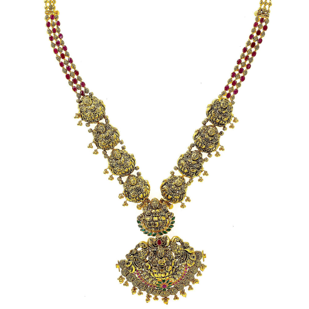 An image of an ornate, temple-style Indian necklace from Virani Jewelers | Add the elegance and beauty of South Asian culture to your attire with this exquisite 22K yellow ...