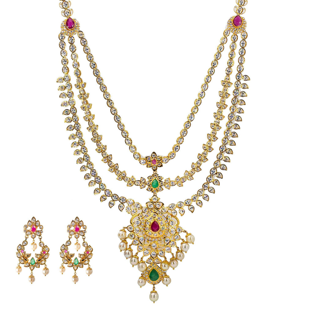 An image of an Indian jewelry set from Virani Jewelers | Looking for an exquisite 22K yellow gold jewelry set to add to your collection? This set from Vir...