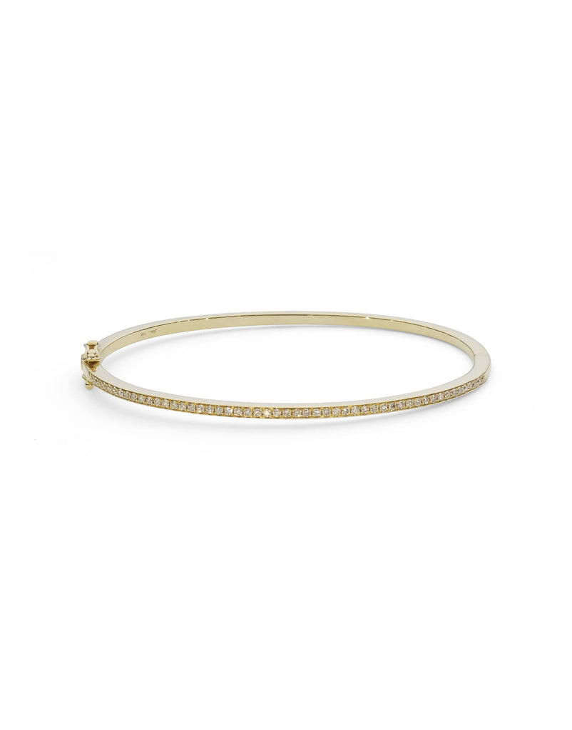 18K White Gold Diamond Bangle W/ 0.29ct Shared Prong Diamonds | Indulge in the guilt-free exploration of precious diamonds and gold of this exquisite women's 18K...