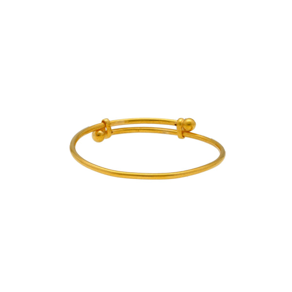 An image of a single 22K gold baby bangle with adjustable band from Virani Jewelers. | Adorn your child with high-quality 22K gold bangles from Virani Jewelers!  Made with Virani's sig...