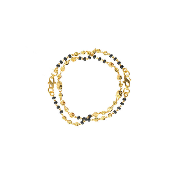 An image of the Riley 22K gold bracelet with gold and black beads from Virani Jewelers. | Help your child feel as fabulous as you do with the Riley 22K gold bracelets from Virani Jewelers...