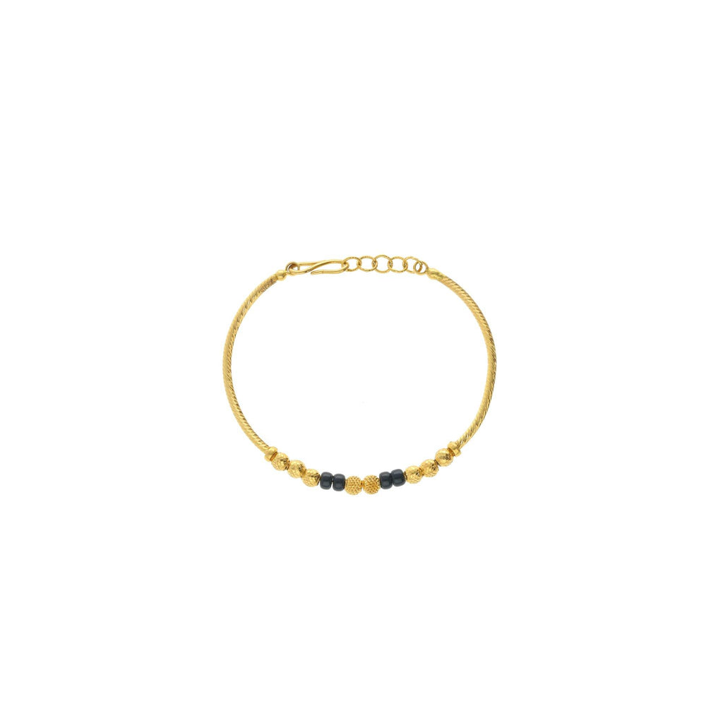 An image showing the beading and chain on the 22K gold bracelet for children from Virani Jewelers. | Enjoy the simple, yet elegant design of this 22K gold bracelet from Virani Jewelers.  Perfect for...
