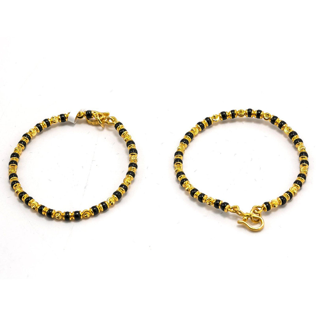 22K Yellow Gold Kids Bangle Set of 2 W/ Textured Beads & Smooth Black Beads | 22K Yellow Gold Kids Bangle Set of 2 W/ Textured Beads & Smooth Black Beads. Adorn your preci...