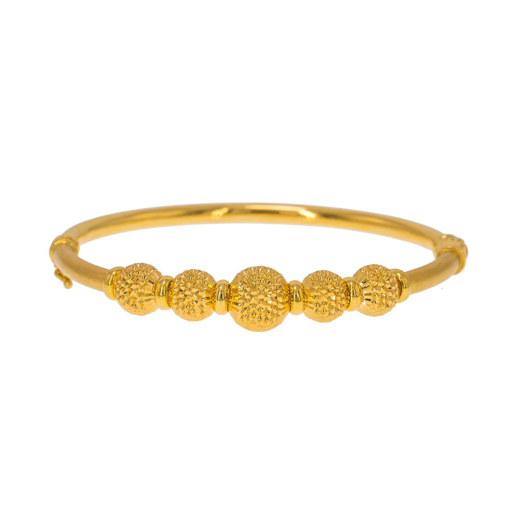 22K Yellow Gold Bangle W/ 5 Accent Dimpled Balls | Create bold accents with radiant blends of gold colors and unique jewelry designs such as this 22...
