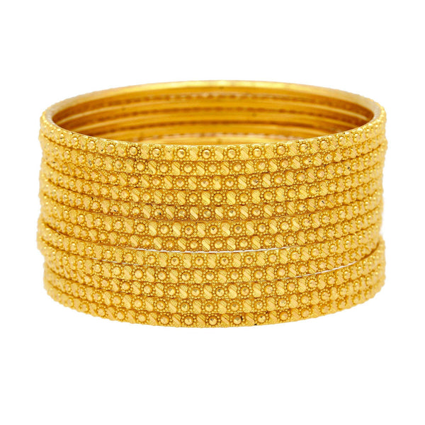 22K Yellow Gold Thin Bangles Set of Twelve, 108.1 Grams |    Enjoy the subtle designs that textures the surfaces of this set of twelve 22K yellow gold thin...