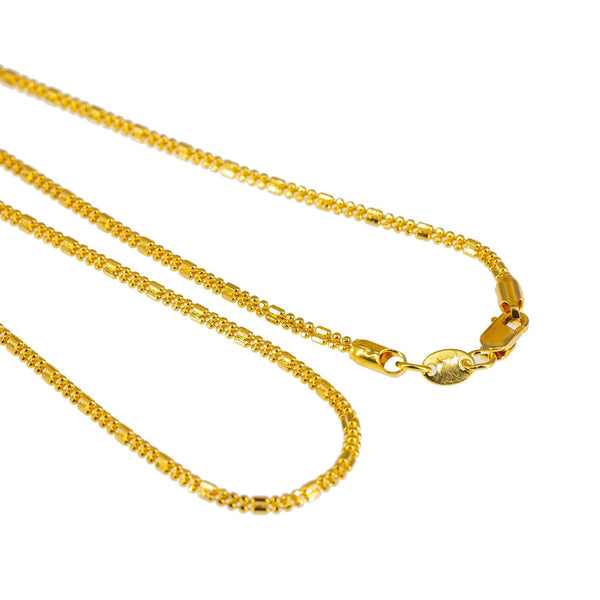 An image of the 22K gold capsule and ball beads on the Indian chain from Virani. | Class up your wardrobe with a 22K gold chain from Virani Jewelers!  Features a shorter chain, mak...