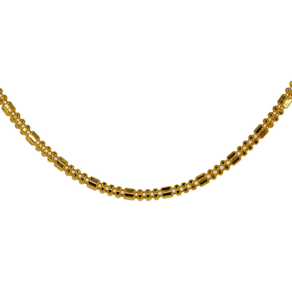 A closeup image of the 22K gold capsule and ball beads on the Indian chain from Virani. | Class up your wardrobe with a 22K gold chain from Virani Jewelers!  Features a shorter chain, mak...