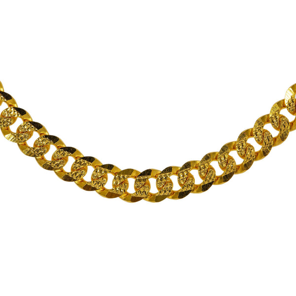 A closeup image of the Cuban-link 22K gold chain from Virani. | Spice up your wardrobe with a classic piece of Indian jewelry from Virani Jewelers!  Features a s...