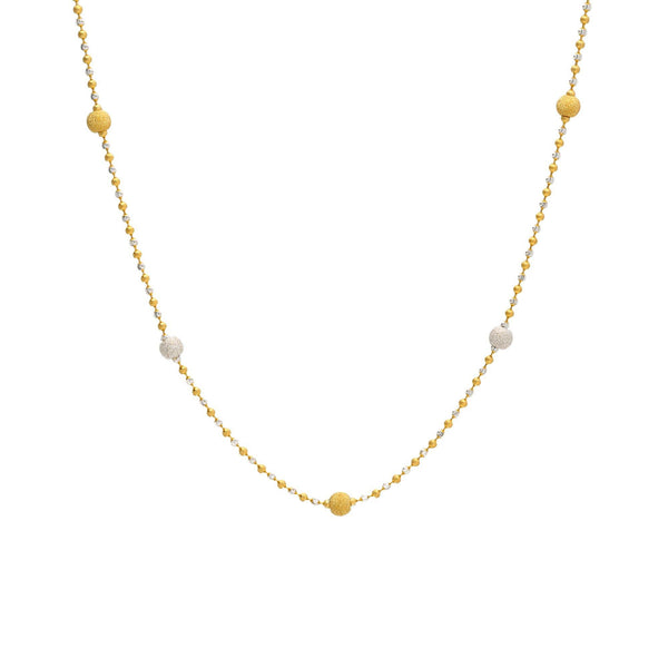 An image of a white and yellow 22K gold necklace with bead accents from Virani Jewelers. | Find the perfect way to accent your ensemble with this 22K gold necklace from Virani Jewelers!  F...
