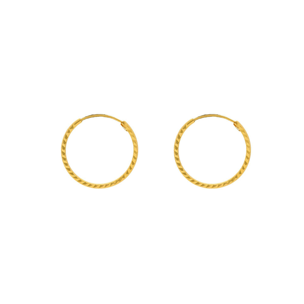 22K Yellow Gold Hammered Hoops, 1.7 Grams |    Petite 22K yellow gold hoops with a unique chiseled detail along the hoop, an ideal pair for a...