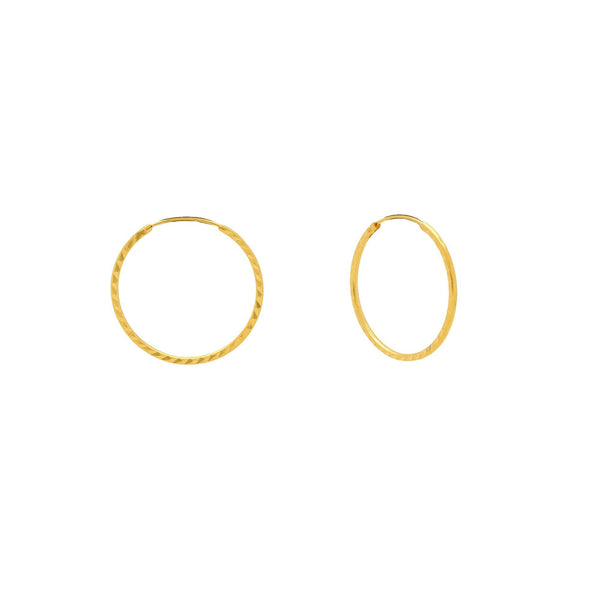 An image showing the side of the 22K gold hoop earrings from Virani Jewelers. | Enhance your natural beauty with these gorgeous minimalist hoops from Virani Jewelers!  Made with...