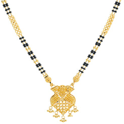 An image of an Indian necklace with a 22K gold pendant crafted by Virani Jewelers