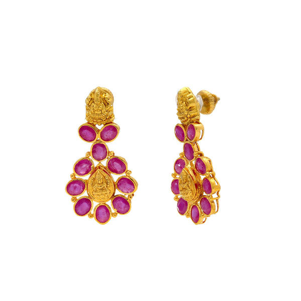 A close-up image showing the post of the Indian gold earrings with ruby embellishments from Virani Jewelers. | Celebrate your culture in style with a beautiful 22K gold necklace set from Virani Jewelers!  Des...