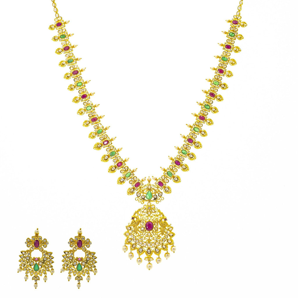 An image of the Bhavna 22K gold necklace set from Virani Jewelers. | Be the most beautiful person in the room with this gorgeous 22K gold necklace set from Virani Jew...