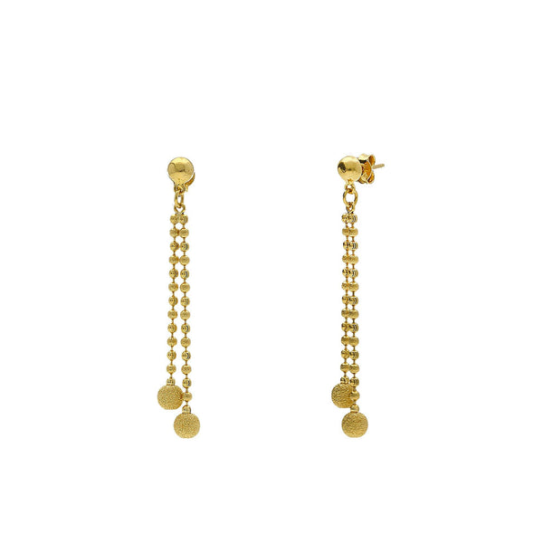 A side view of 22K yellow gold earrings from Virani Jewelers | Use this 22K yellow gold necklace and earring set from Virani Jewelers to add lustrous elegance t...