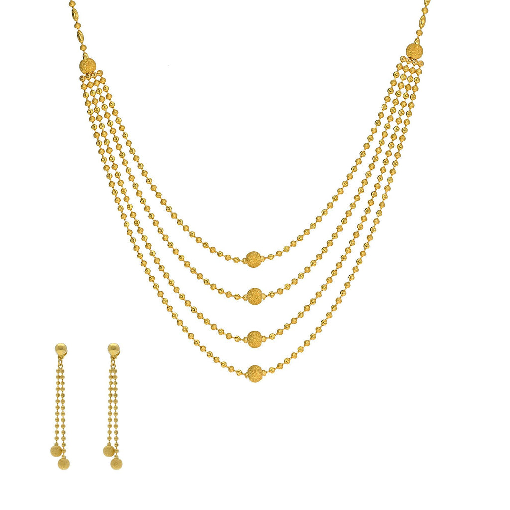 An image of a beautiful Indian jewelry set featuring a necklace and earrings from Virani Jewelers | Use this 22K yellow gold necklace and earring set from Virani Jewelers to add lustrous elegance t...