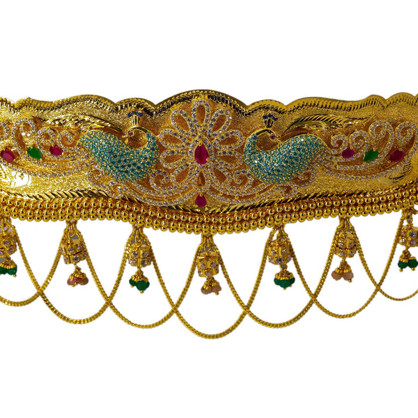 A close-up shot of the gem-studded peacocks and gold rope chandeliers that decorate the 22K waist belt from Virani Jewelers. | Add movement and luxury to your most festive looks with Vaddanam waist belts that will transform ...