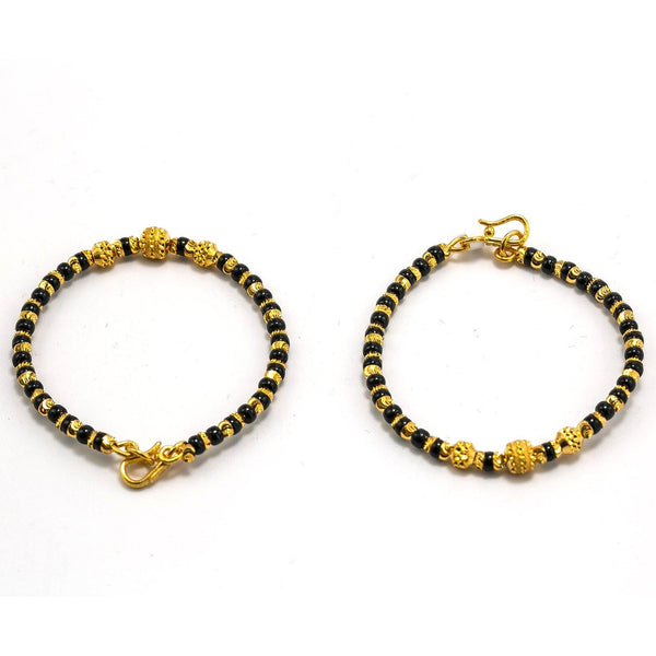 22K Yellow Gold Kids Bangle Set of 2 W/ Smooth Black Beads & Large Textured Ball Accents | 22K Yellow Gold Kids Bangle Set of 2 W/ Smooth Black Beads & Large Textured Ball Accents. Ado...